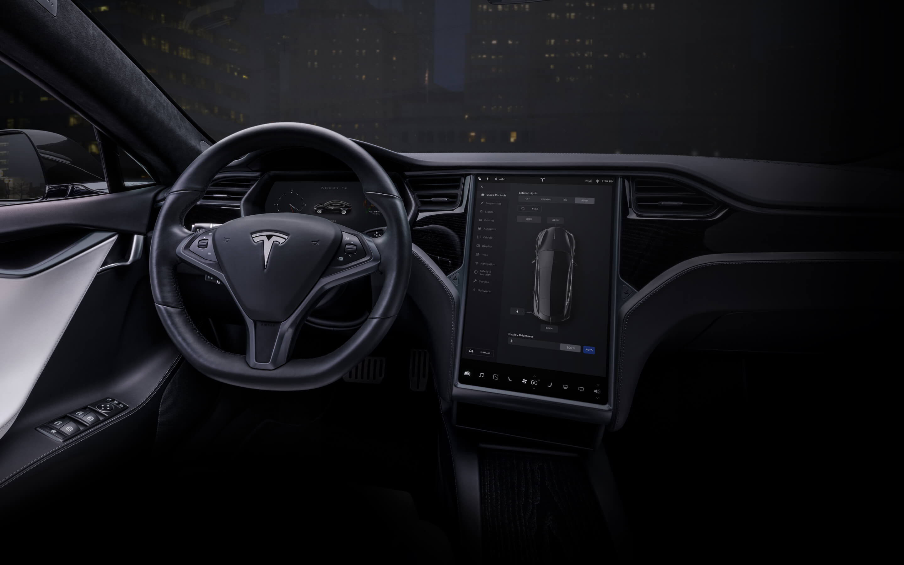 "Black Model S interior with 17"" touchscreen and steering wheel"