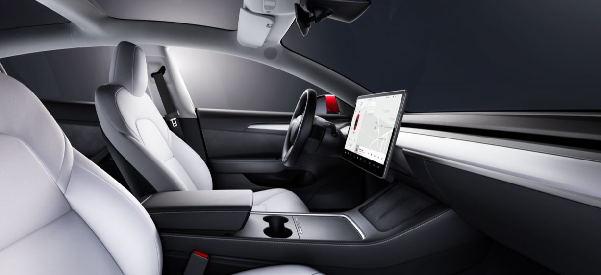 Front seat view inside a Model 3 with white interior