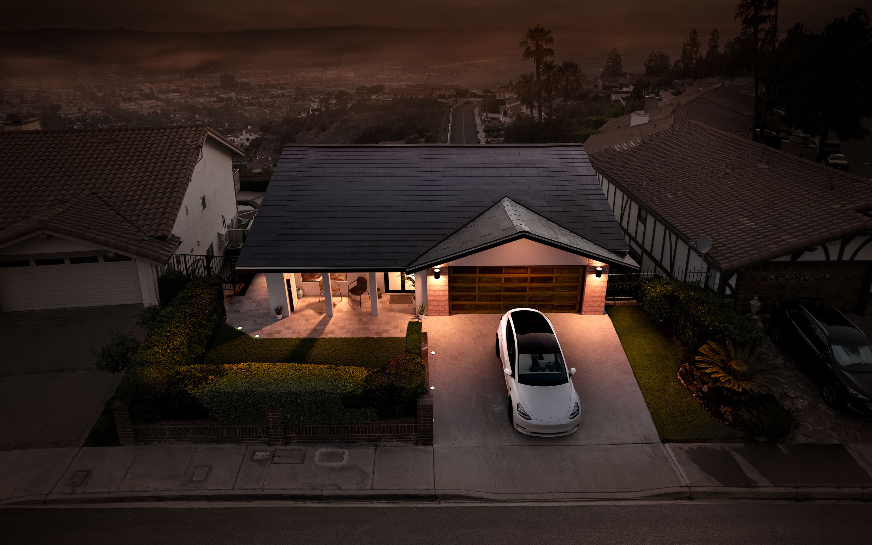 Solar Roof on single story home with white Model 3 in driveway