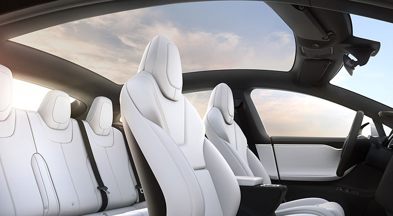 Expansive glass roof covering white Model S interior and 5 seats