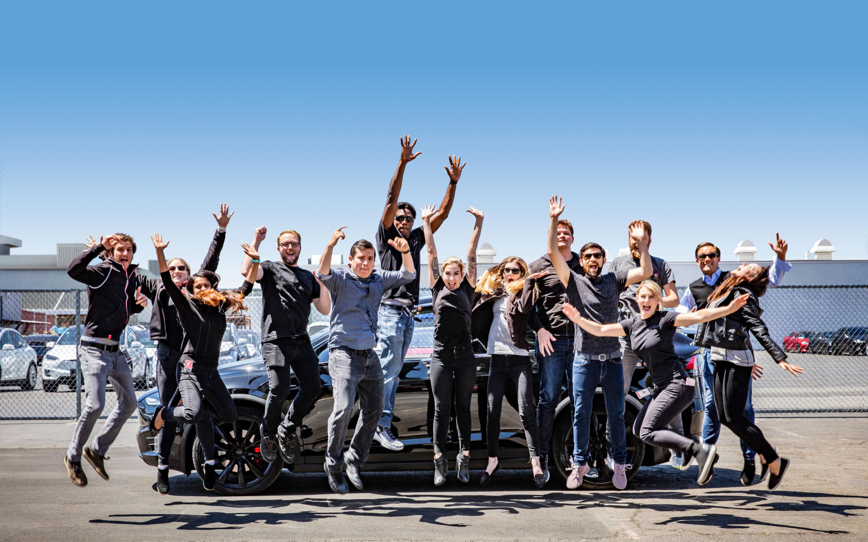 Tesla interns jumping.