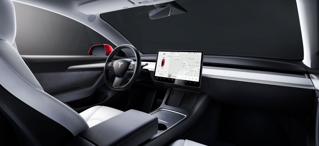 Backseat view from inside a Model 3 with white interior