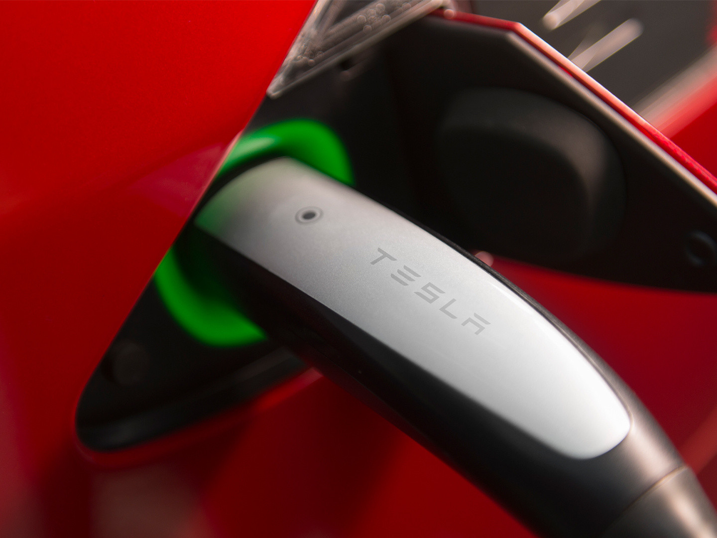 Supercharger plugged into a Tesla charge port