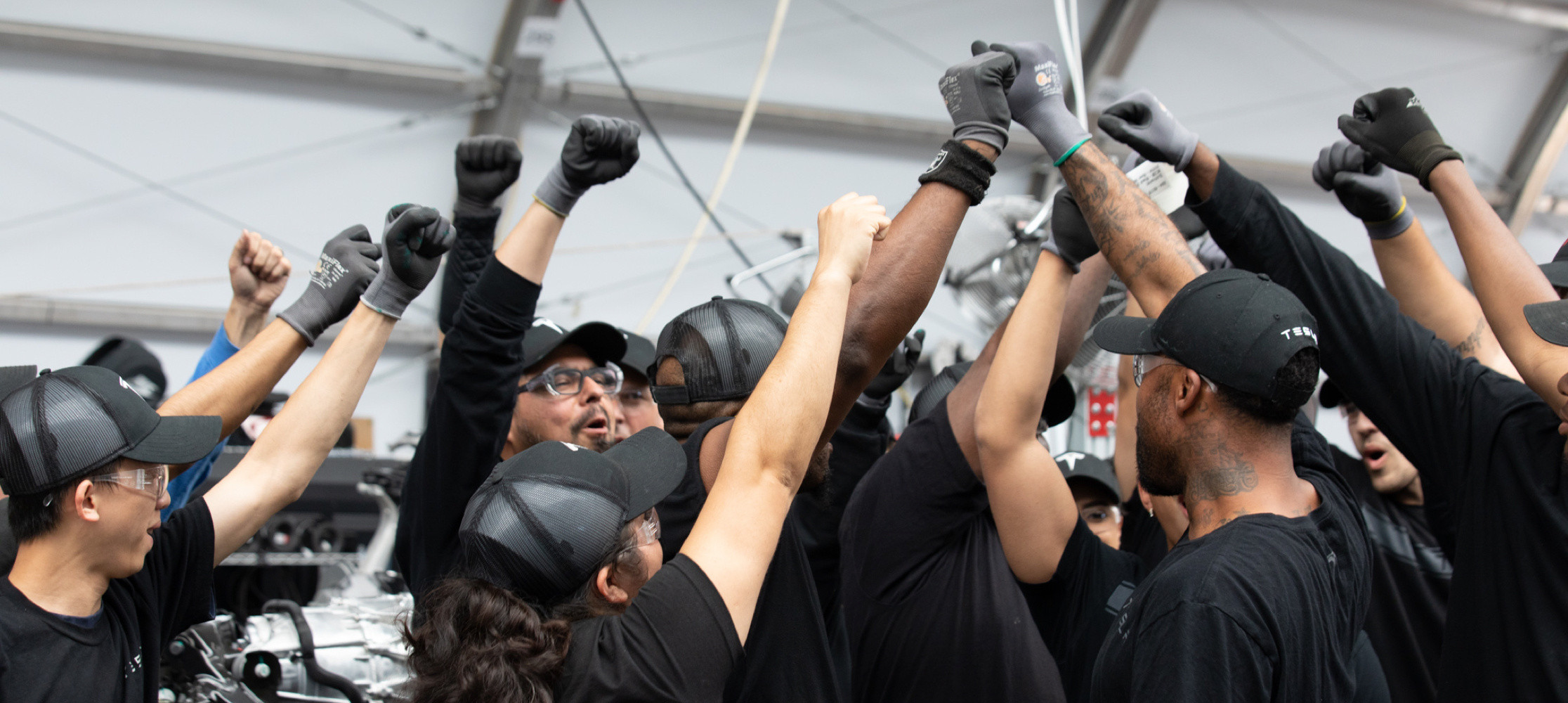 Tesla employees uniting at the factory.